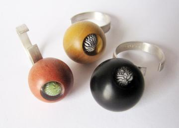 Contemporary Ring Sphere Ebony and Zebra shell magnified : $107