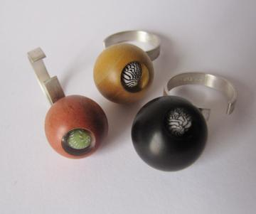 Ring 91 - Pink Ivory wood with Emerald Nerite : $107